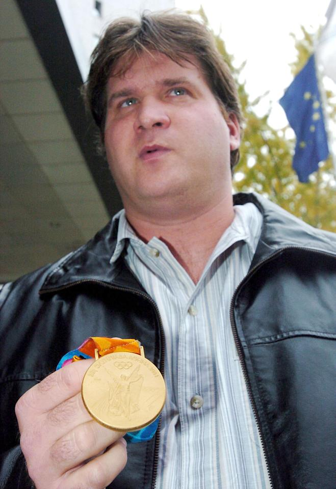 Technicaly, Hungarian thrower Adrián Annus has never tested positive for steroids. But he lost his 2004 Olympic gold medal in the hammer throw after it was determined he had used urine samples belonging to different people for his drug tests. (AP Photo/MTI, Szilard Koszticsak)