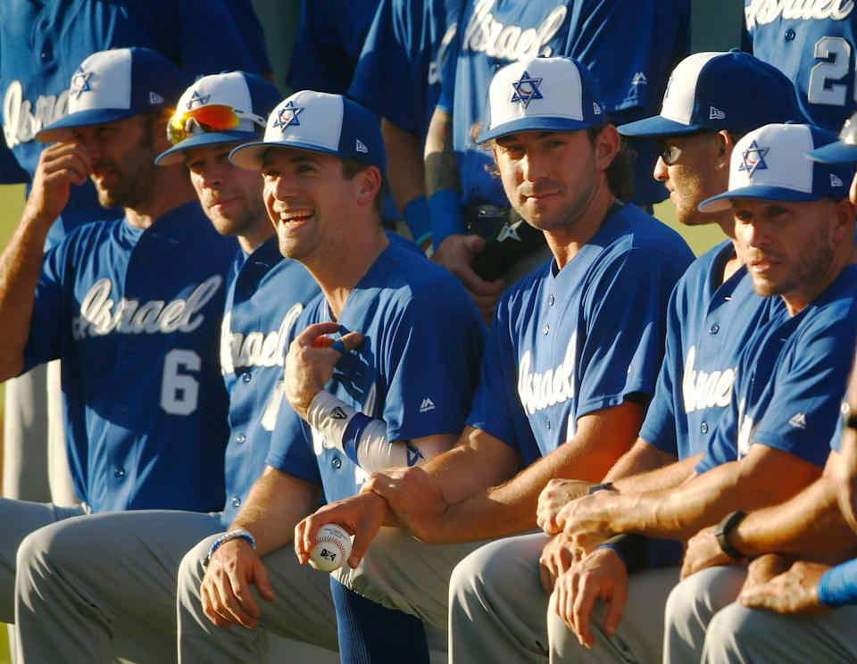 The Israel baseball team gathers for group pictures before a game on Thursday in Arizona.