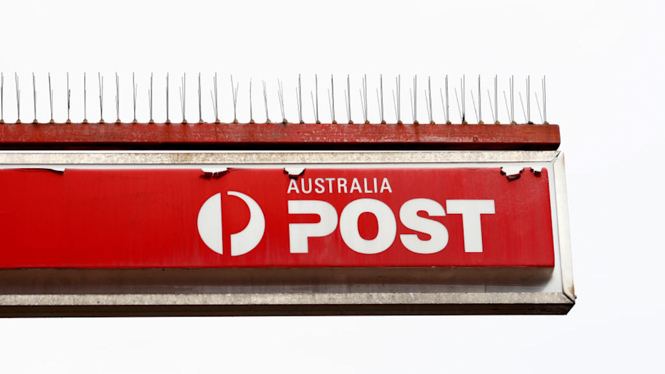 Australia Post has been inundated. (Image: Getty).