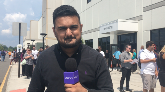 All the waiting was worth it for Shaheryar Abbasi, a Pennsylvania State University graduate who got a job in operations after an interview with three recruiters. He told Yahoo Finance that he's already looking forward to promotion opportunities at Amazon. (Krystal Hu/Yahoo Finance)