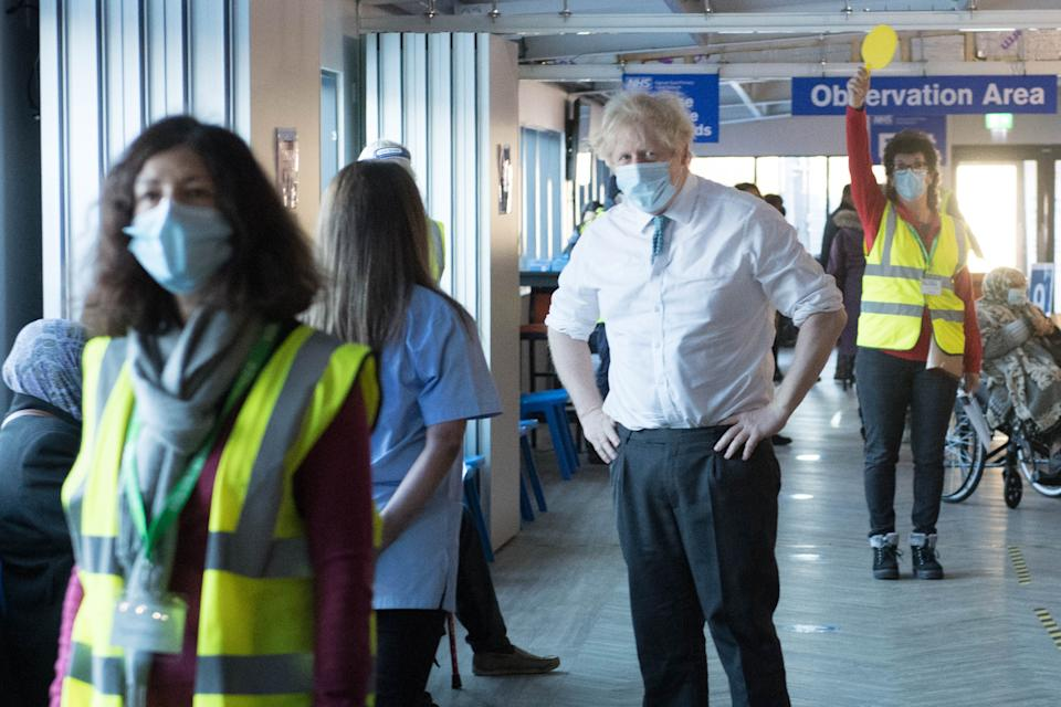 Prime Minister Boris Johnson meets staff and patients at Barnet FC's ground, The Hive, north London, which is being used as a coronavirus vaccination centre. Picture date: Monday January 25, 2021.