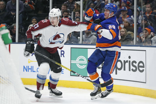 Colorado Avalanche defenseman Ryan Graves (27) fends off New York Islanders center Brock Nelson (29) during the second period of an NHL hockey game, Monday, Jan. 6, 2020, in Uniondale, N.Y. (AP Photo/Kathy Willens)