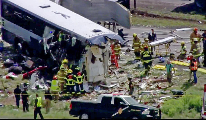 This photo from video provided by KQRENews13 shows first responders working the scene of a collision between a Greyhound passenger bus and a semi-truck on Interstate 40 near the town of Thoreau, N.M., near the Arizona border, Thursday, Aug. 30, 2018. Multiple people were killed and others were seriously injured. Officers and rescue workers were on scene but did not provide details about how many people were killed or injured, or what caused the crash. (KQRENews13 via AP)