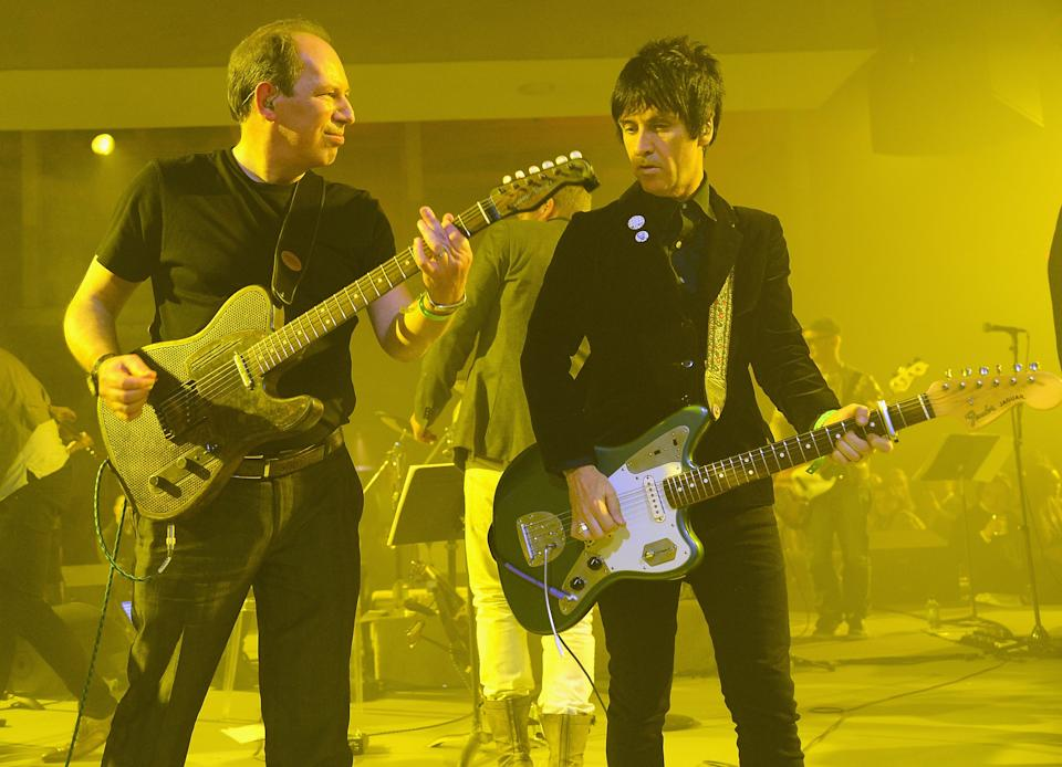 """NEW YORK, NY - APRIL 24:  Hans Zimmer and Johnny Marr perform during the """"The Amazing Spider-Man 2"""" New York Premiere at Skylight at Moynihan Station on April 24, 2014 in New York City.  (Photo by Theo Wargo/WireImage)"""