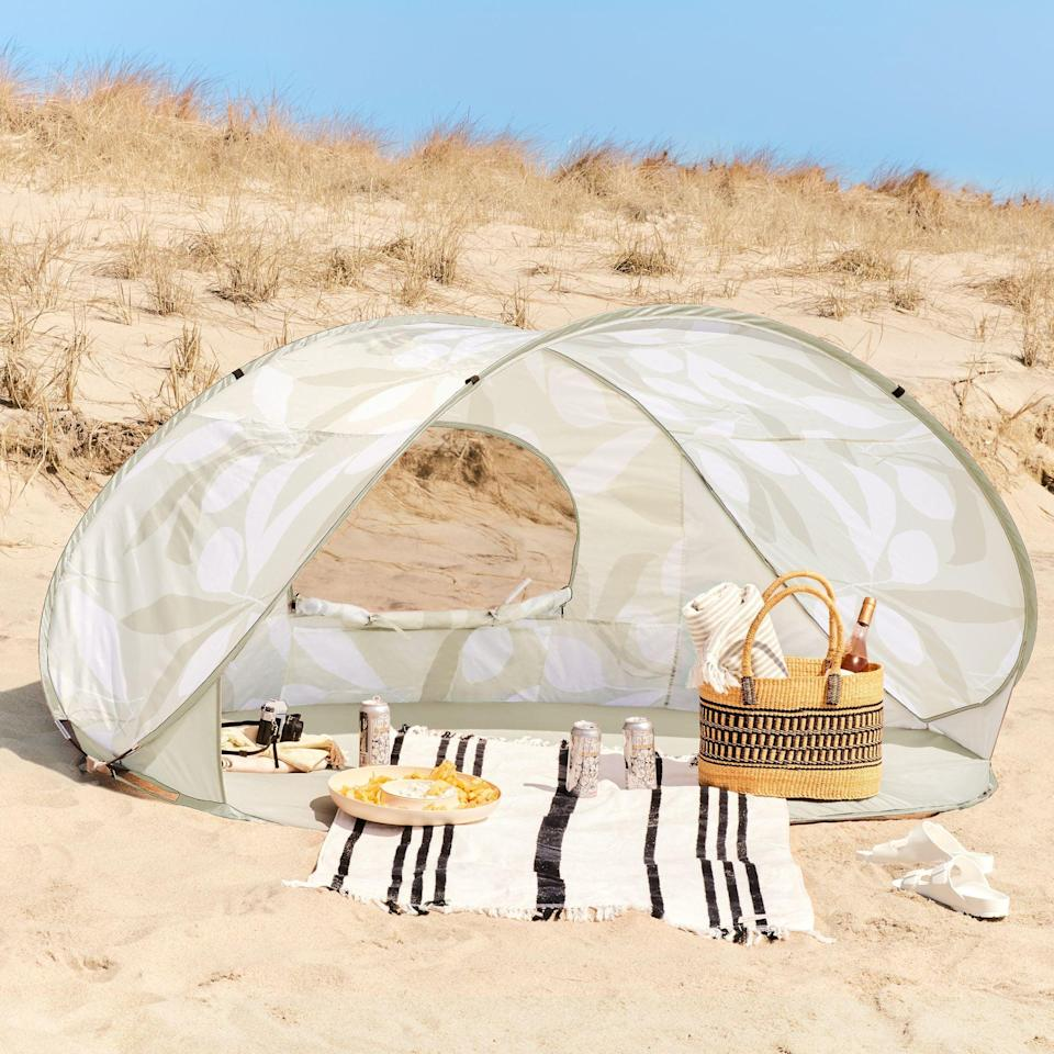 """<h2>Food52 x Kate Roebuck Sun Shelter Pop-Up Tent</h2><br>This gorgeous, leaf-patterned tent practically sets up itself. Just pull it out of it its travel-friendly case and watch as it pops into shape. The tropical finish makes it the ideal backdrop for your next romantic beach picnic. <br><br><em><strong>Shop </strong><a href=""""https://food52.com/shop/collections/food52-x-kate-roebuck-outdoor-living-collection"""" rel=""""nofollow noopener"""" target=""""_blank"""" data-ylk=""""slk:Food52 x Kate Roebuck"""" class=""""link rapid-noclick-resp""""><strong>Food52 x Kate Roebuck</strong></a></em><br><br><strong>Food52 x Kate Roebuck</strong> Sun Shelter Pop-Up Tent, $, available at <a href=""""https://go.skimresources.com/?id=30283X879131&url=https%3A%2F%2Ffood52.com%2Fshop%2Fproducts%2F8332-food52-x-kate-roebuck-sun-shelter-pop-up-tent"""" rel=""""nofollow noopener"""" target=""""_blank"""" data-ylk=""""slk:Food52"""" class=""""link rapid-noclick-resp"""">Food52</a>"""