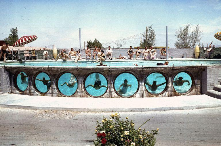 <p>Swimmers look through underwater portholes in a pool at a Las Vegas hotel in 1955. Pools were a must, even in the '50s, since temps in the summer can easily surpass 100 degrees Fahrenheit.</p>
