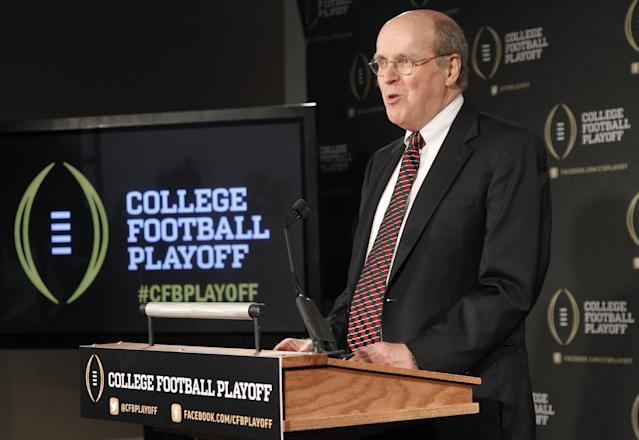 Bowl Championship Series Executive Director Bill Hancock announces the 13 members of the College Football Playoff committee during a news conference, Wednesday, Oct. 16, 2013, in Irving, Texas. Former Secretary of State Rice, former Nebraska coach Tom Osborne and College Football Hall of Fame quarterback Archie Manning are among the 13 people who will be part of the College Football Playoff selection committee in 2014. (AP Photo/Tony Gutierrez)