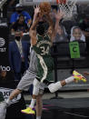 Milwaukee Bucks forward Giannis Antetokounmpo (34) is blocked as he tries to score against San Antonio Spurs center Jakob Poeltl during the second half of an NBA basketball game in San Antonio, Monday, May 10, 2021. (AP Photo/Eric Gay)