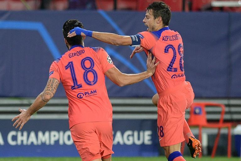 Giroud (L) produced a remarkable four-goal display