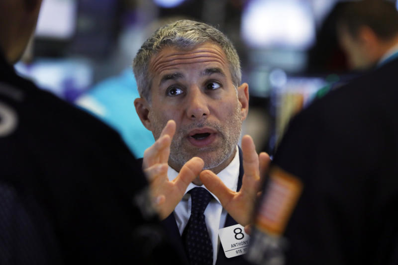 Specialist Anthony Rinaldi talks with colleagues on the floor of the New York Stock Exchange, Tuesday, June 11, 2019. Stocks are rising early Tuesday as Wall Street continues to thrive in June. (AP Photo/Richard Drew)