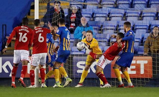 "Soccer Football - League One - Shrewsbury Town vs Charlton Athletic - Montgomery Waters Meadow, Shrewsbury, Britain - April 17, 2018 Shrewsbury Town's Dean Henderson in action with Charlton's Josh Magennis Action Images/Andrew Boyers EDITORIAL USE ONLY. No use with unauthorized audio, video, data, fixture lists, club/league logos or ""live"" services. Online in-match use limited to 75 images, no video emulation. No use in betting, games or single club/league/player publications. Please contact your account representative for further details."