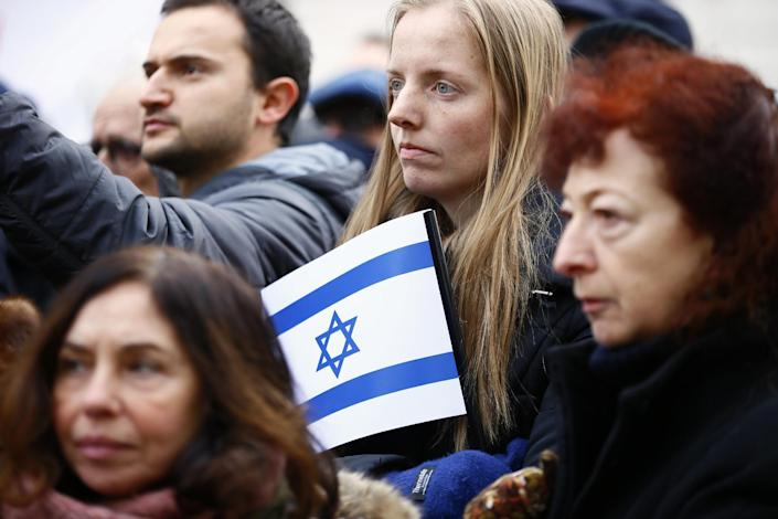 Pro-Israel demonstrators listen to speeches during a gathering in front of Israel embassy in Paris, France, Sunday, Jan. 15, 2017. Fearing a new eruption of violence in the Middle East, more than 70 world diplomats gathered in Paris on Sunday to push for renewed peace talks that would lead to a Palestinian state. (AP Photo/Francois Mori)