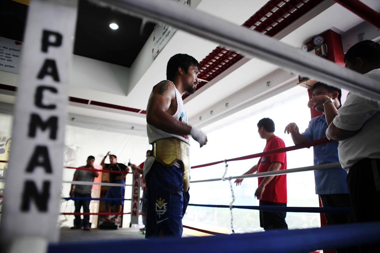 GENERAL SANTOS, PHILIPPINES - OCTOBER 09: Manny Pacquiao takes part in a training session on October 9, 2013 in General Santos, Philippines. Pacquiao will fight against Brandon Rios on November 23rd. (Photo by Jeoffrey Maitem/Getty Images)