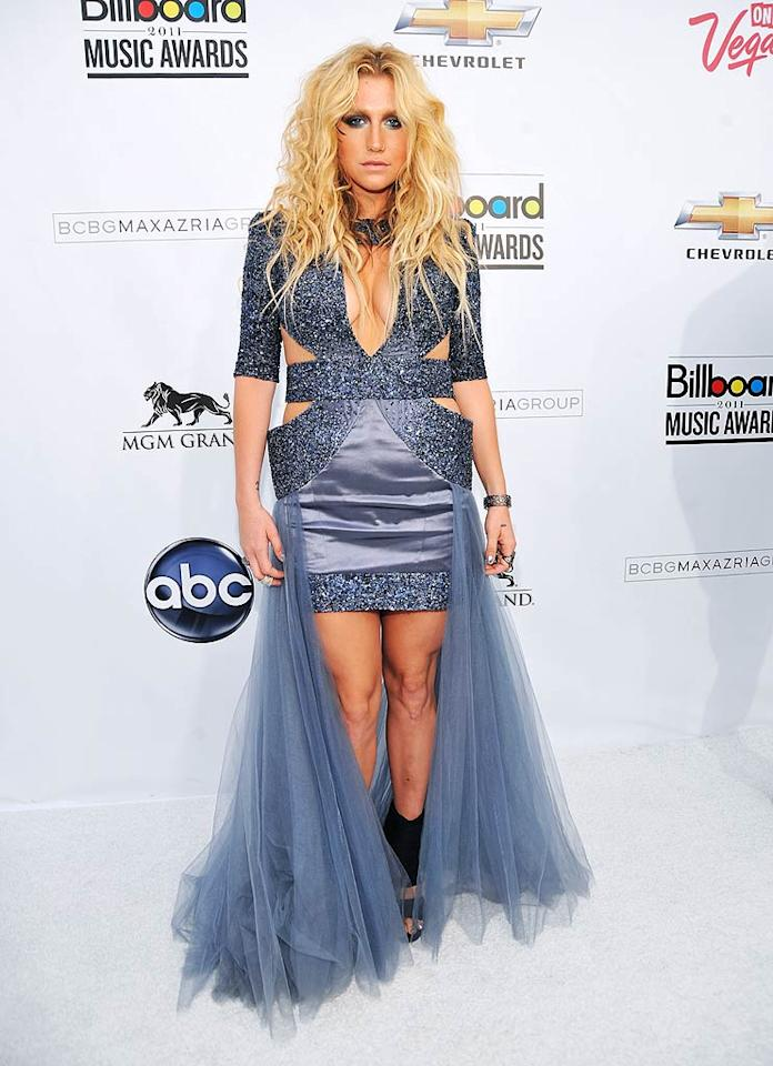 """Just how many dresses is Ke$ha wearing? The fashion disaster donned a sparkly purple number -- with what looks like a dress hanging off each side! -- some dowdy black footwear, and <i>way</i> too much face paint. Kevin Mazur/<a href=""""http://www.wireimage.com"""" target=""""new"""">WireImage.com</a> - May 22, 2011"""