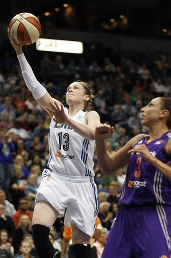 Minnesota Lynx guard Lindsay Whalen (13) goes up for the basket against Phoenix Mercury guard Diana Taurasi (3) in the first half of a WNBA basketball game, Thursday, June 6, 2013, in Minneapolis. (AP Photo/Stacy Bengs)