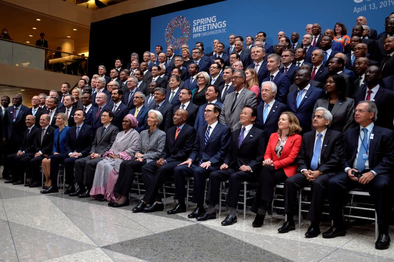 FILE PHOTO: Central bank governors and other global finance officials sit for a group photo at the IMF and World Bank's 2019 Annual Spring Meetings, in Washington