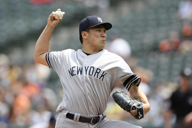 New York Yankees starting pitcher Masahiro Tanaka, of Japan, delivers a pitch during the first inning of a baseball game against the Baltimore Orioles, Thursday, May 23, 2019, in Baltimore. (AP Photo/Nick Wass)