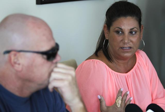 Laurie Navon, girlfriend of former NFL football quarterback Jim McMahon, speaks during a news conference Tuesday, June 17, 2014 in Chicago. McMahon spoke of his ongoing battle with dementia that he believe is related to his years of hits he took while playing in the league. McMahon is part of a federal lawsuit filed in San Francisco accusing teams of illegally dispensing powerful narcotics and other drugs to keep players on the field without regard for their long-term health. He led the Chicago Bears to victory in the 1985 Super Bowl. (AP Photo/Stacy Thacker)