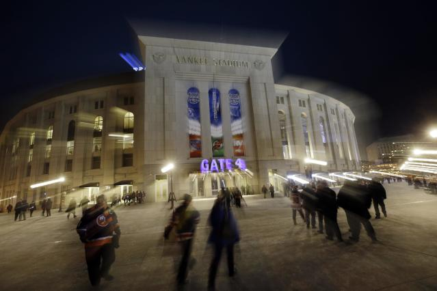 Fans arrive for an outdoor NHL hockey game between the New York Islanders and the New York Rangers Wednesday, Jan. 29, 2014, at Yankee Stadium in New York. (AP Photo/Frank Franklin II)