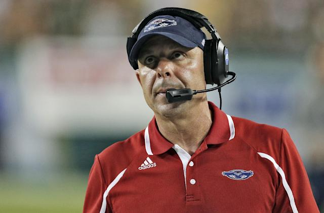 FILE- In this Sept. 14, 2013, file photo, Florida Atlantic head coach Carl Pelini watches during the fourth quarter of an NCAA college football game against South Florida in Tampa, Fla. Florida Atlantic says Pelini resigned on Wednesday, Oct. 30, 2013, after acknowledging to school officials that he used illegal drugs. (AP Photo/Chris O'Meara, File)