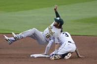 Oakland Athletics second baseman Chad Pinder (18) falls onyo Seattle Mariners' J.P. Crawford after tagging Crawford out at second base on a stolen-base attempt during the fifth inning of a baseball game Saturday, Aug. 1, 2020, in Seattle. (AP Photo/Elaine Thompson)