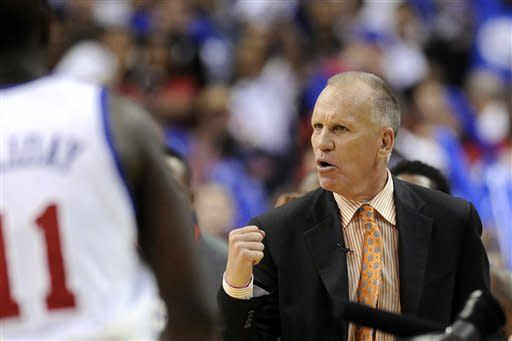 Philadlephia 76ers coach Doug Collins pumps his fist during a timeout in the second half of Game 4 in a first-round NBA basketball playoff series against the Philadelphia 76ers in Philadelphia, Sunday, May 6, 2012. The 76ers won 89-82. (AP Photo/Michael Perez)