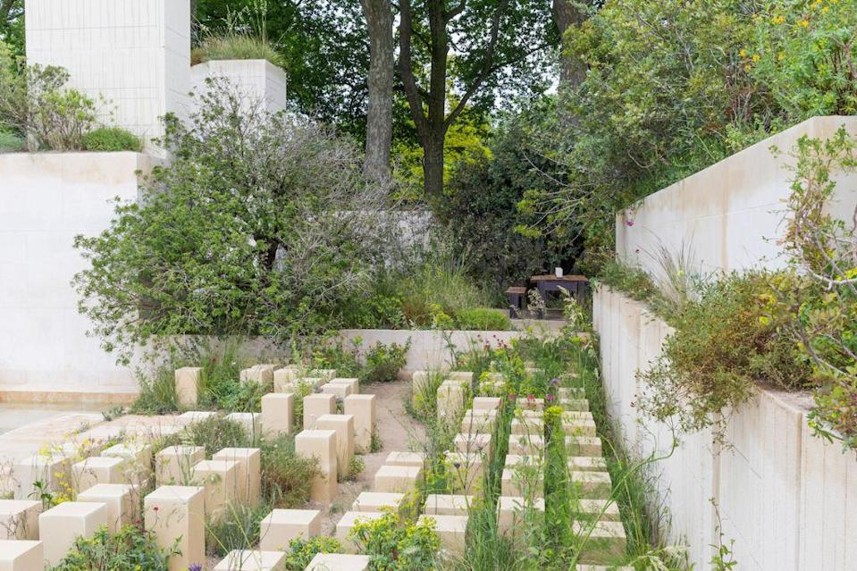 """<p>It took centre stage in <a rel=""""nofollow noopener"""" href=""""http://www.housebeautiful.co.uk/garden/news/a1765/rhs-chelsea-flower-show-special-awards/"""" target=""""_blank"""" data-ylk=""""slk:James Basson's award-winning garden at RHS Chelsea last year"""" class=""""link rapid-noclick-resp"""">James Basson's award-winning garden at RHS Chelsea last year</a>, so it's no surprise that limestone is set to make a return to the domestic garden. This year, we'll see the introduction of """"harder-wearing mid-toned stones rather than the bright white varieties of a few years ago, reflecting the natural, warm colour palettes popular in interior design"""". </p><p>Adolfo Harrison MSGD also predicts a trend towards mixing different stones together to reflect the various colours and tones within the garden itself.<br></p>"""