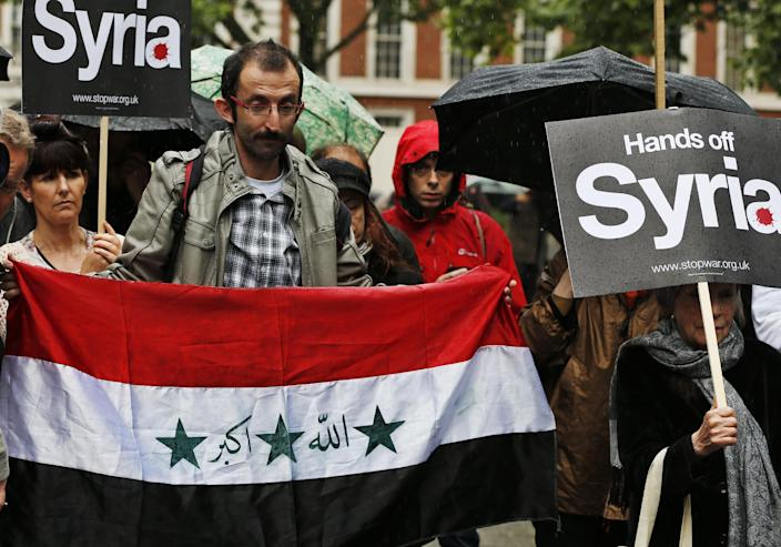 Protesters demonstrate against western intervention in Syria, outside the US embassy in central London, Saturday, June 15, 2013.(AP Photo/Lefteris Pitarakis)
