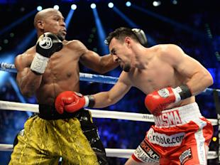 Floyd Mayweather punches Robert Guerrero their WBC welterweight title fight. (USA Today)