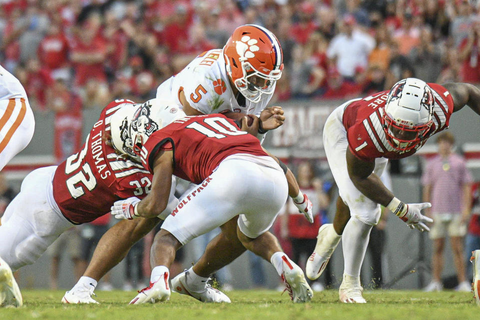 RALEIGH, NC - SEPTEMBER 25: Clemson Tigers quarterback D.J. Uiagalelei (5) is hit on a keeper during the game between the Clemson Tigers and the NC State Wolfpack on September 25, 2021 at Carter-Finley Stadium in Raleigh, NC. (Photo by William Howard/Icon Sportswire via Getty Images)
