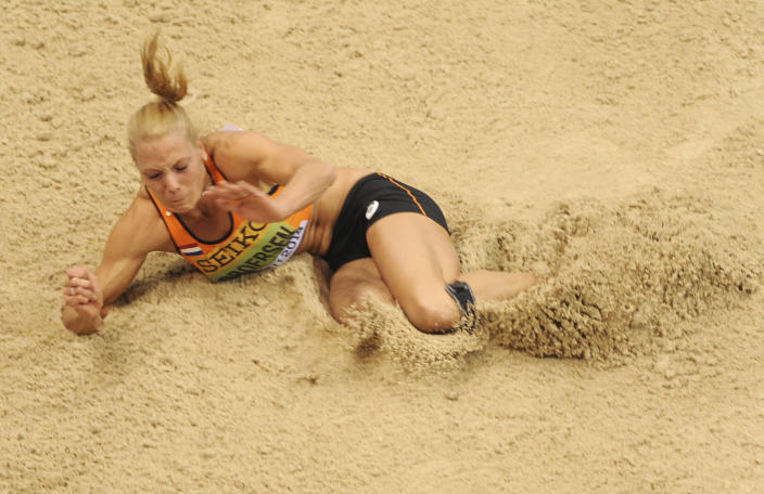 Netherlands' Nadine Broersen makes an attempt in the long jump of the women's pentathlon during the Athletics Indoor World Championships in Sopot, Poland, Friday, March 7, 2014. (AP Photo/Alik Keplicz)