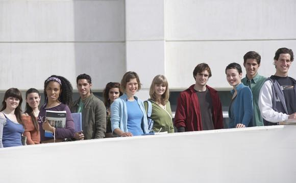 Group of 20-somethings standing side-by-side.