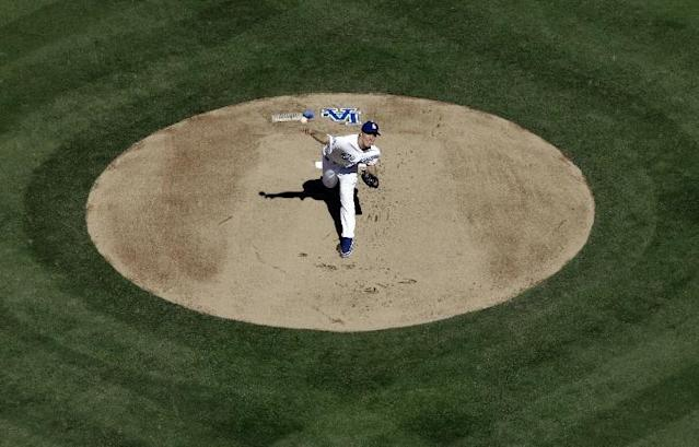 Los Angeles Dodgers starting pitcher Zack Greinke throws during the first inning of Game 5 of the National League baseball championship series against the St. Louis Cardinals Wednesday, Oct. 16, 2013, in Los Angeles. (AP Photo/Morry Gash)