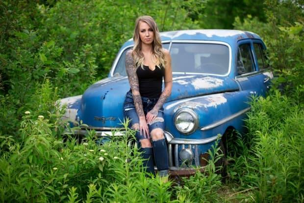 Jordana Lee takes a rest with a 1950s DeSoto, as photographed by Garry Black.