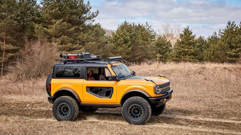 2021 Ford Bronco two-door yellow driving off-road from the side