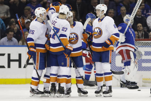 New York Islanders' Anders Lee (27) celebrates with teammates after scoring a goal during the second period of an NHL hockey game against the New York Rangers Tuesday, Jan. 21, 2020, in New York. (AP Photo/Frank Franklin II)