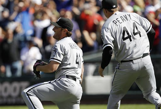 Chicago White Sox starting pitcher Philip Humber, left, reacts after pitching a perfect baseball game against the Seattle Mariners, Saturday, April 21, 2012, in Seattle. The White Sox won 4-0. (AP Photo/Elaine Thompson)