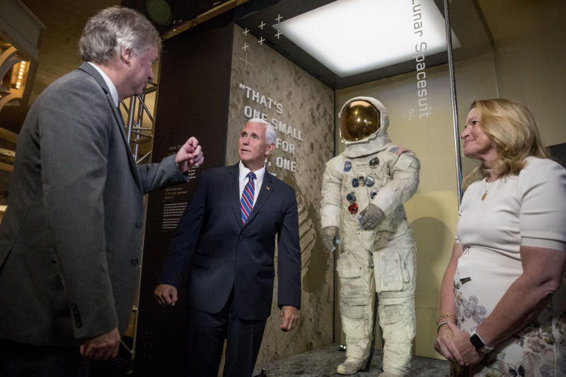 From left, Rick Armstrong, the son of Neil Armstrong, Vice President Mike Pence, and Smithsonian's National Air and Space Museum Director Ellen Stofan, speak together after unveiling Neil Armstrong's Apollo 11 spacesuit at the Smithsonian's National Air and Space Museum on the National Mall in Washington, Tuesday, July 16, 2019. (AP Photo/Andrew Harnik, Pool)