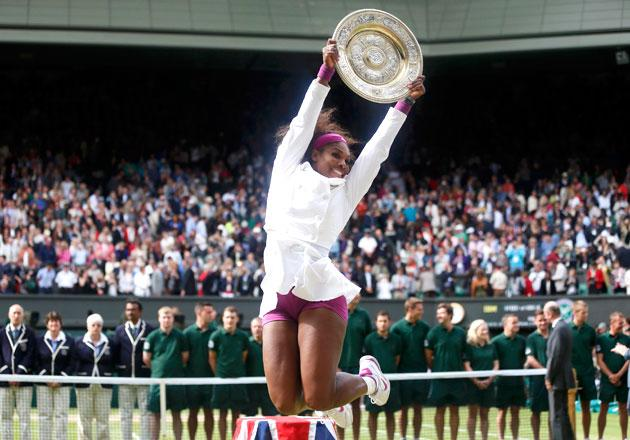 Serena Williams of the U.S. holds her trophy after defeating Agnieszka Radwanska of Poland in their women's final tennis match at the Wimbledon tennis championships in London July 7, 2012.     REUTERS/Stefan Wermuth