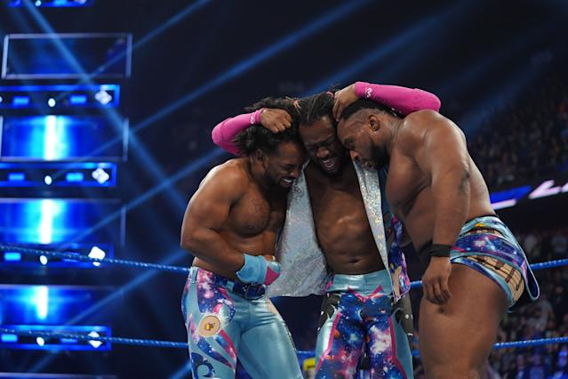 """WWE star Kofi Kingston celebrates with <a class=""""link rapid-noclick-resp"""" href=""""/nfl/players/30304/"""" data-ylk=""""slk:Xavier Woods"""">Xavier Woods</a> and Big E after a tag-team gauntlet match on """"Smackdown Live."""" (Photo courtesy of WWE)"""