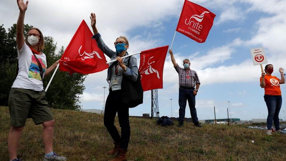 Easyjet employees demonstrate outside Stansted Airport, on August 20, 2020 following the decision by the airline to close its operations at Stansted