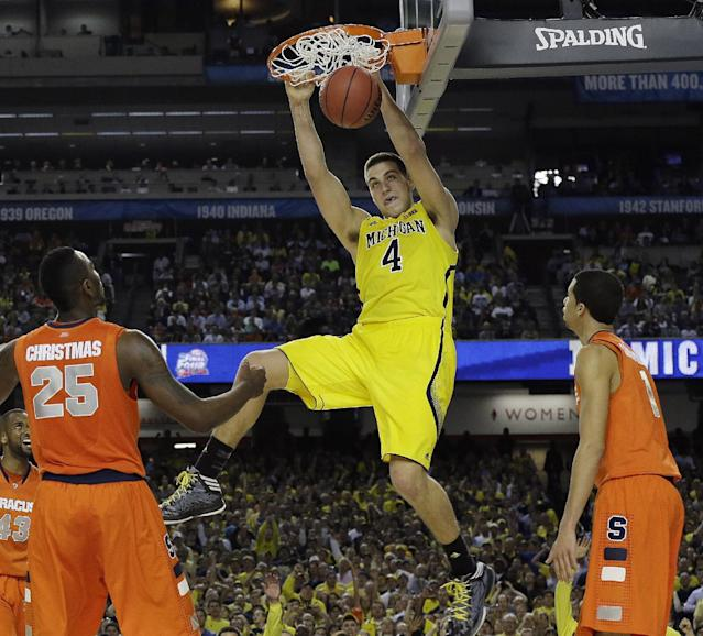 FILE - In this April 6, 2013 file photo, Michigan's Mitch McGary dunks the ball against Syracuse during the second half of the NCAA Final Four tournament college basketball semifinal game, in Atlanta. McGary was selected to The Associated Press' preseason All-America team, released Monday, Nov. 4, 2013. (AP Photo/Charlie Neibergall, File)