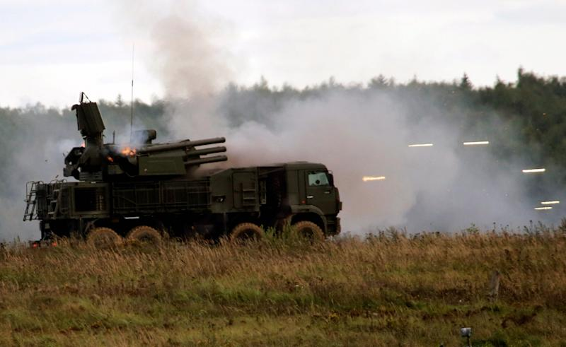 A Russian Pantsir-S1 missile and artillery weapon system fires during a demonstration at the international military-technical forum