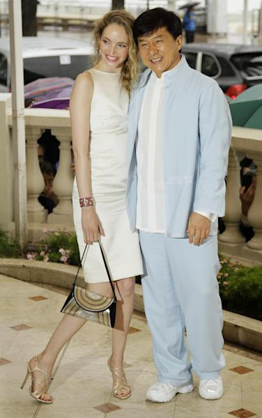 Actress Laura Weissbecker, left, and director Jackie Chan during a photo call for Chinese Zodiac at the 65th international film festival, in Cannes, southern France, Friday, May 18, 2012. (AP Photo/Francois Mori)