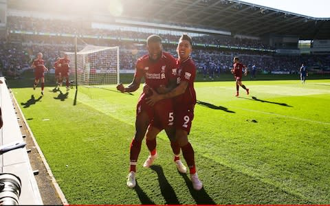 eorginio Wijnaldum of Liverpool celebrates scoring their 1st goal with Roberto Firmino during the Premier League match between Cardiff City and Liverpool - Credit: OFFSIDE