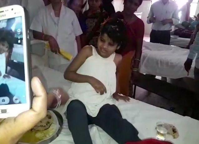 A young Indian girl sits on a bed at a hospital in this image taken from video in Bahraich northern India. Source: AP