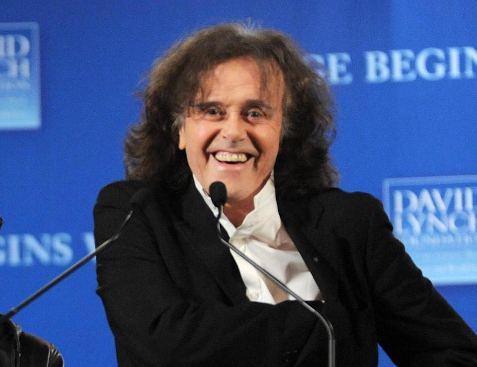 "FILE - This April 3, 3009 file photo shows musician Donovan participating in news conference to promote the ""Change Begins Within"" benefit concert for the David Lynch Foundation in New York. Donovan and Ray Davies are among the 2014 Songwriters Hall of Fame class. The organization announced Tuesday that ""Midnight Train to Georgia"" writer Jim Weatherly and English songwriter Graham Gouldman also made the cut. Mark James, the writer behind ""Always on My Mind"" _ covered by Elvis Presley and Willie Nelson _ rounds out the list of five inductees. The Songwriters Hall of Fame gala will be held June 12 at the New York Marriott Marquis. (AP Photo/Evan Agostini, File)"
