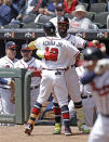Atlanta Braves' Marcell Ozuna congratulates Ronald Acuna Jr. (13) after Acuna hit a home run off Toronto Blue Jays' Ross Stripling in the first inning of a baseball game Thursday, May 13, 2021, in Atlanta. (AP Photo/Ben Margot)