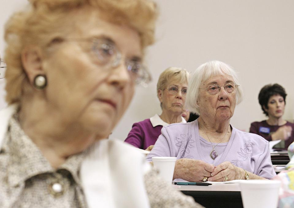 SUN CITY, AZ - NOVEMBER 21:  Residents of Sun City, Arizona listen to Norma Hamilton, of Adult Care Assistance, explain some of the options and benefits of the new Medicare drug prescription program at the city library November 21, 2005 in Sun City, Arizona. Open enrollment for the new program began November 15 and will continue through May 15, 2006.  (Photo by Jeff Topping/Getty Images)