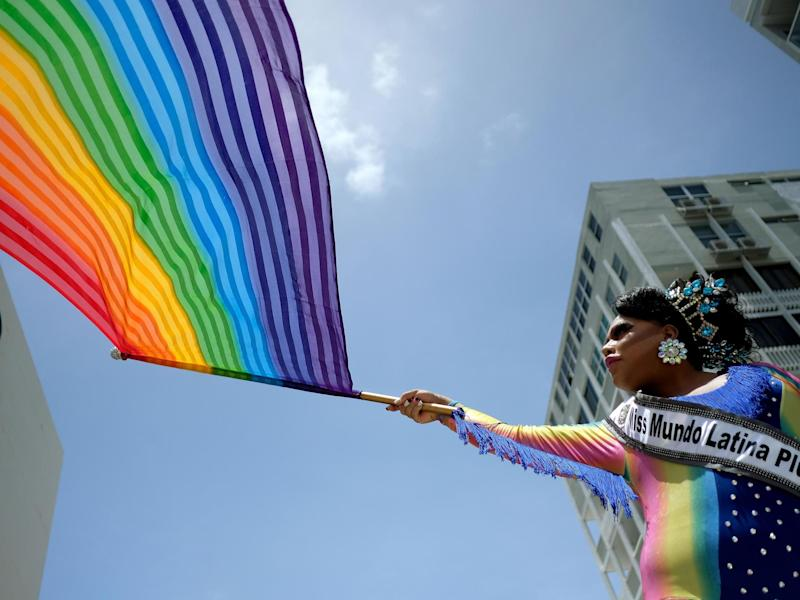People take part in the annual Gay Pride parade in San Juan, Puerto Rico: AFP via Getty Images